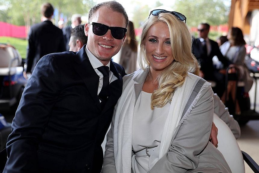 Danny Willett and his wife Nicole attending the Ryder Cup opening ceremony on Thursday. He has come under fire for disparaging comments written by his brother Peter on American golf spectators.
