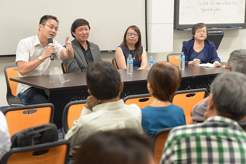 Mr Poon King Wang (far left) suggested staggering work hours to ease MRT congestion. With him are (from left) Mr Koh Buck Song, Ms Joanna Tan and Ms Cheong Suk-Wai.