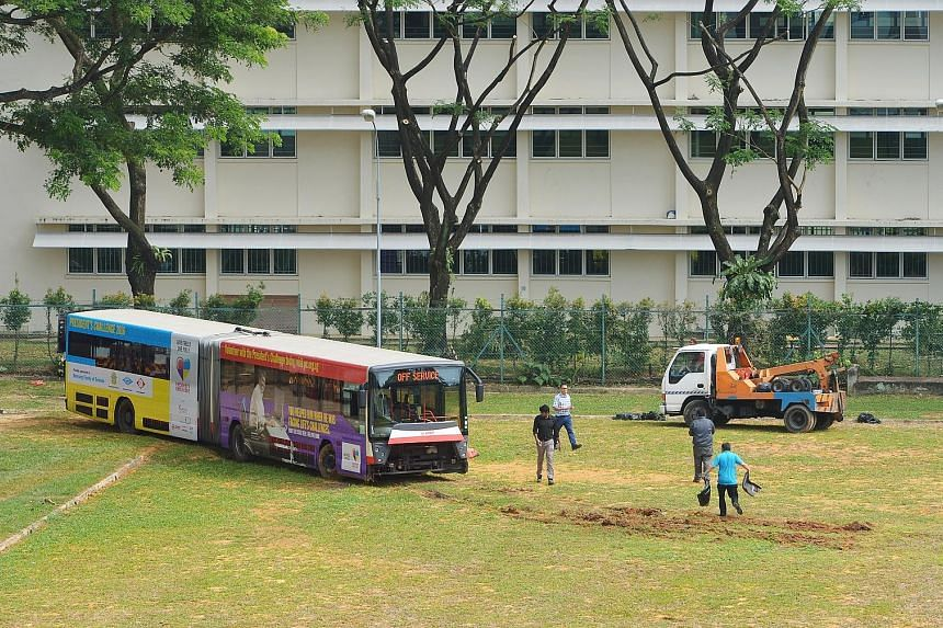 First a field, now a tennis court - buses have been ending up in the wrong places the past two days. An SBS Transit bus (right) yesterday evening crashed onto a tennis court when making a turn in Yio Chu Kang bus interchange, a day after an SMRT bend