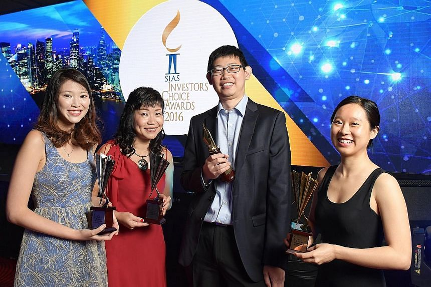 From left: ST journalists Marissa Lee and Lorna Tan with BT reporters Kenneth Lim and Melissa Tan at the Sias Investors' Choice Awards last night. SPH won the Most Transparent Company Award in the Consumer Discretionary category. It also clinched a M