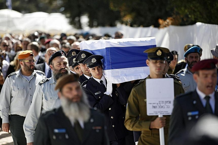 An honour guard carrying the coffin of Mr Shimon Peres yesterday.