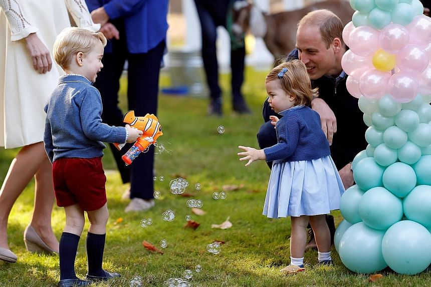 """Britain's Princess Charlotte, one, has spoken for the first time in public during her family's Canadian tour, uttering the word """"pop"""" while she and her brother played with balloons. Britain's Prince William and his wife Catherine, Duchess of Cambridg"""