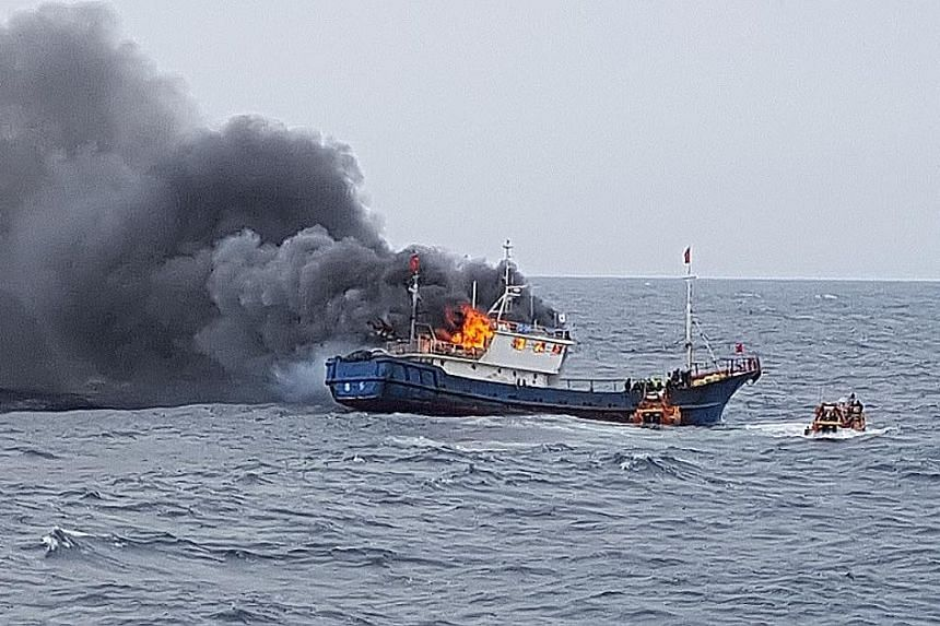 The Chinese fishing boat on fire in South Korean waters near the south-western port of Mokpo on Thursday. South Korea's coast guard had boarded it for illegal fishing.