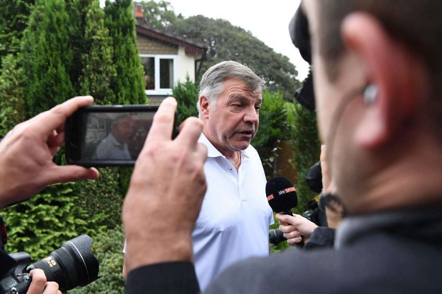 Former England national football team manager Sam Allardyce speaks to the press outside his home in Bolton, England, on Sept 28, 2016.