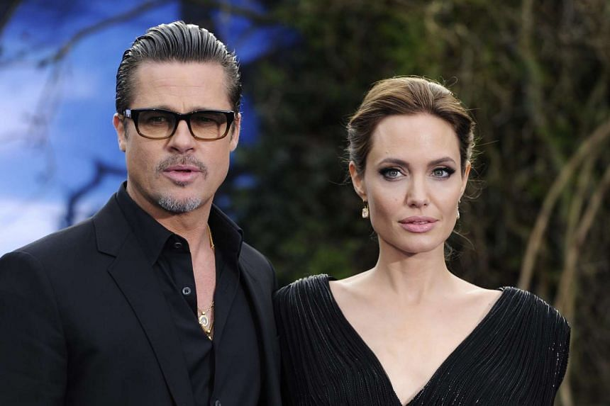 Angelina Jolie and Brad Pitt arrive for an event in London in 2014.