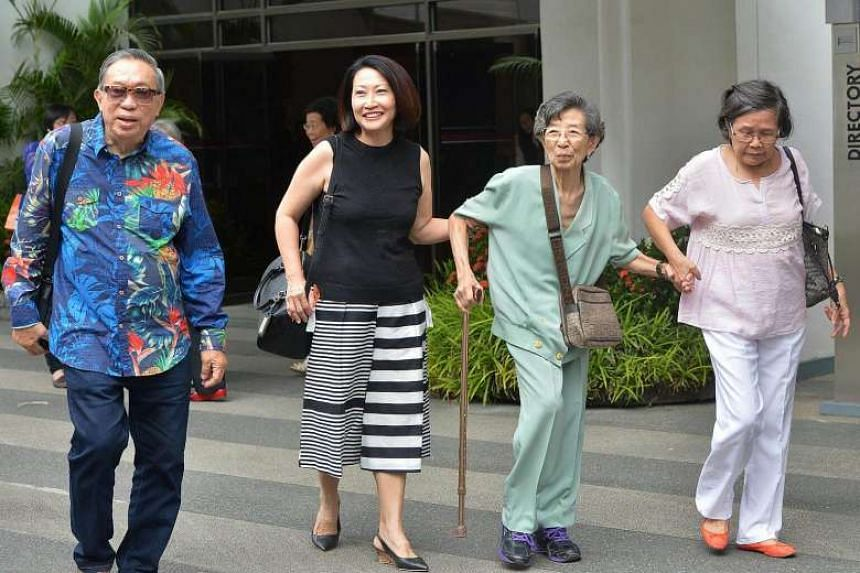 Friends and supporters of Madam Chung walk out of the State Courts.
