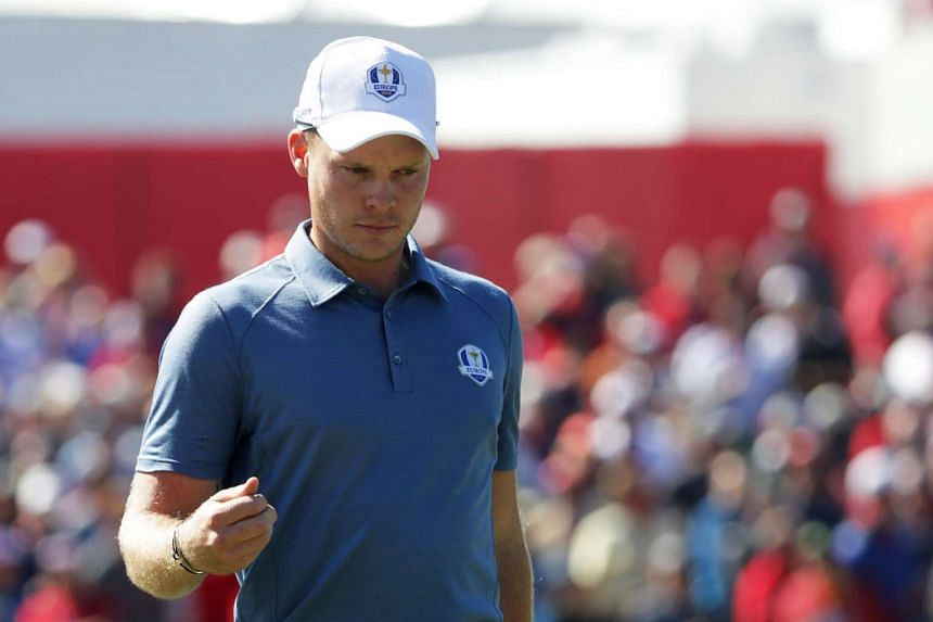 Danny Willett of Europe reacts after putting on the first green during afternoon fourball matches of the 2016 Ryder Cup.