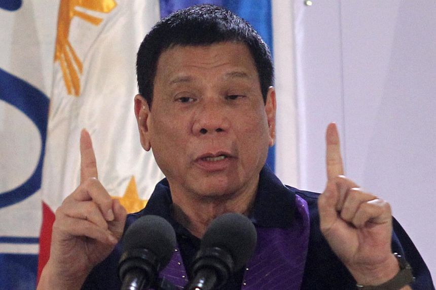 Philippines President Rodrigo Duterte gestures while delivering a speech before female police officers during a gathering in Davao city, Philippines.