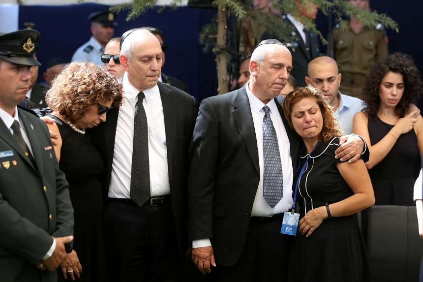 "Nechemia ""Chemi"" Peres (centre, left) and Yoni Peres (centre, right), the sons of former Israeli premier Shimon Peres, mourn with relatives."