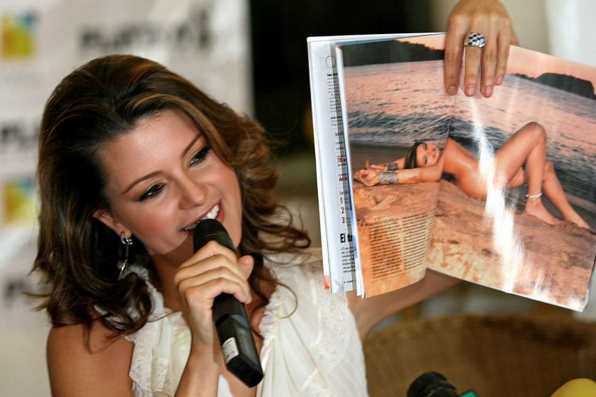 Alicia Machado, former Miss Universe 1996, holding an issue of Playboy Mexico with her picture on Feb 7, 2006.
