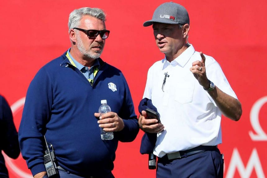 Captain Darren Clarke (left) of Europe and captain Davis Love III of the United States at the 2016 Ryder Cup on Sept 30, 2016.
