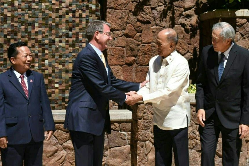 US Defense Secretary Ashton Carter (left) shakes hands with Philippines Defense Minister Delfin Lorenzana at an Asean security meeting in Hawaii, on Sept 30, 2016.