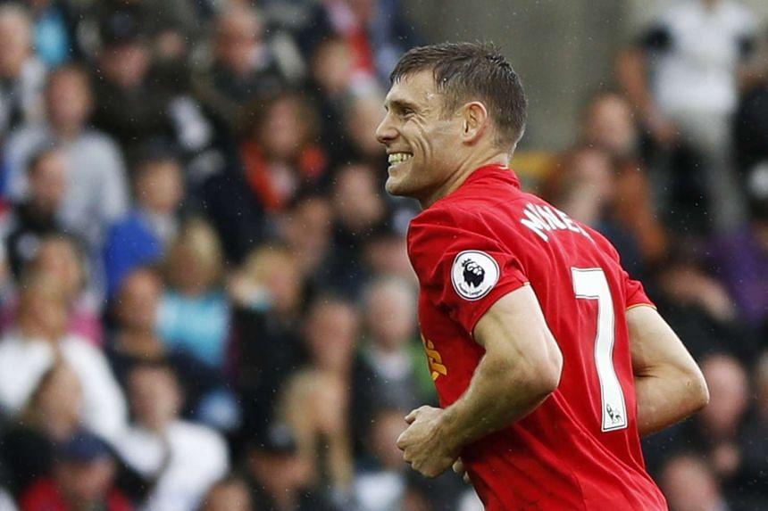 Liverpool's James Milner celebrates scoring their second goal.