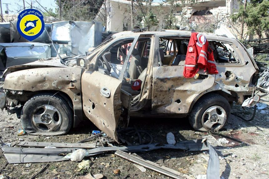 The remains of a humanitarian convoy organised by the Red Crescent and the Red Cross that was bombed in an air-strike in Syria.