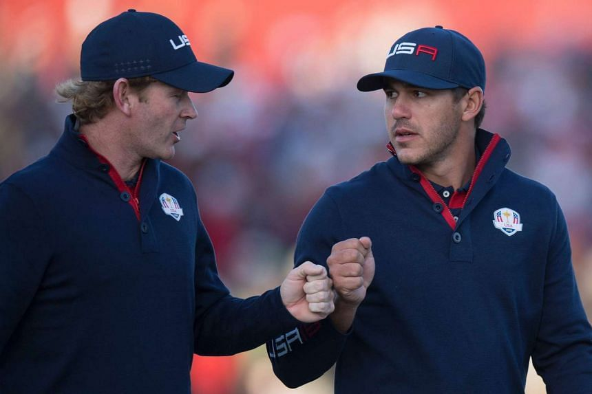 The US' Brandt Snedeker (left) and Brooks Koepka bump fists while playing the Saturday morning foursomes matches.
