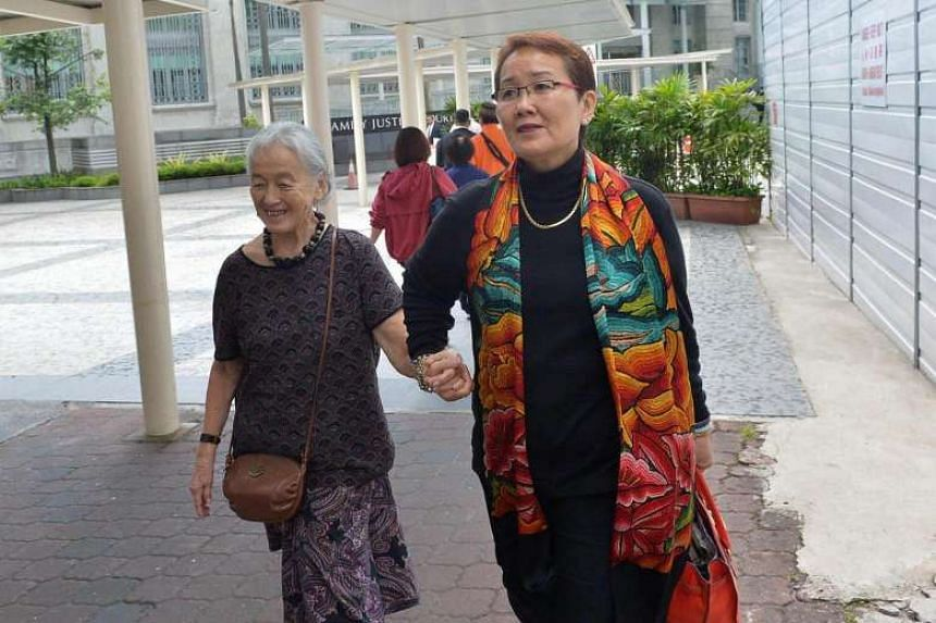 Madam Chung Khin Chun (left) and Madam Mok arrive at the State Courts on Sept 30.