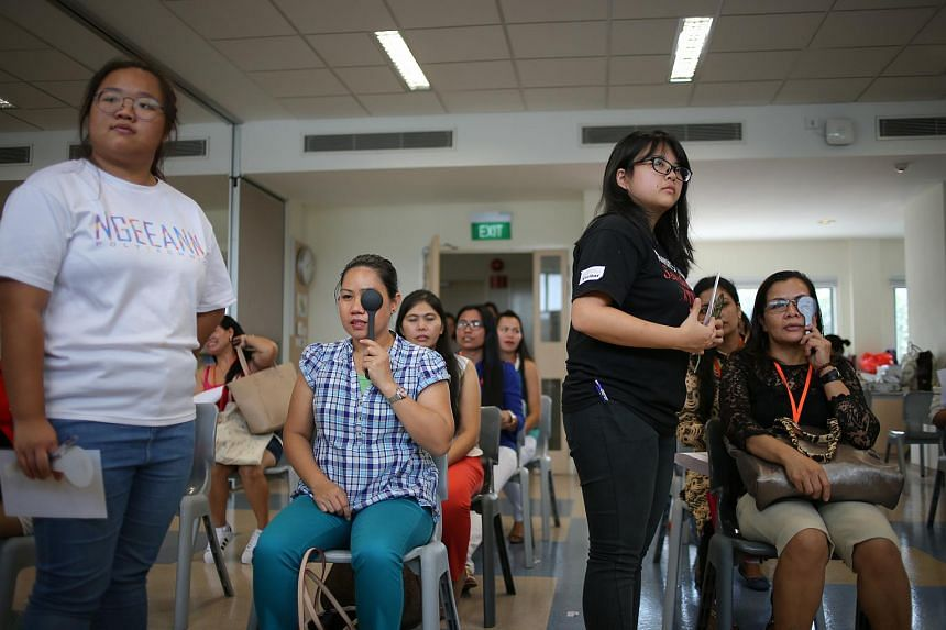 Foreign domestic helpers receive free eye checks from Essilor Vision Foundation and Optometry for Sight at United World College of South East Asia.