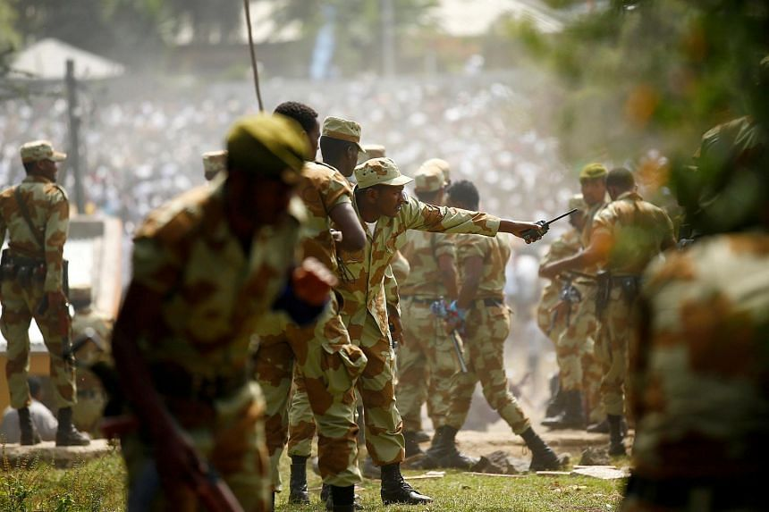 Security personnel attempt to stop protesters during the Irrechaa, the thanksgiving festival of the Oromo people in Bishoftu town of Oromia region, Ethiopia on Oct 2, 2016.