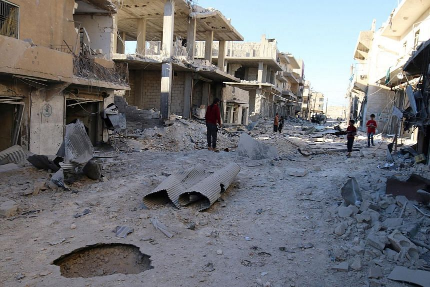 People inspect a damaged site after airstrikes on the rebel held Sheikh Fares neighbourhood of Aleppo, Syria on Oct 2, 2016.