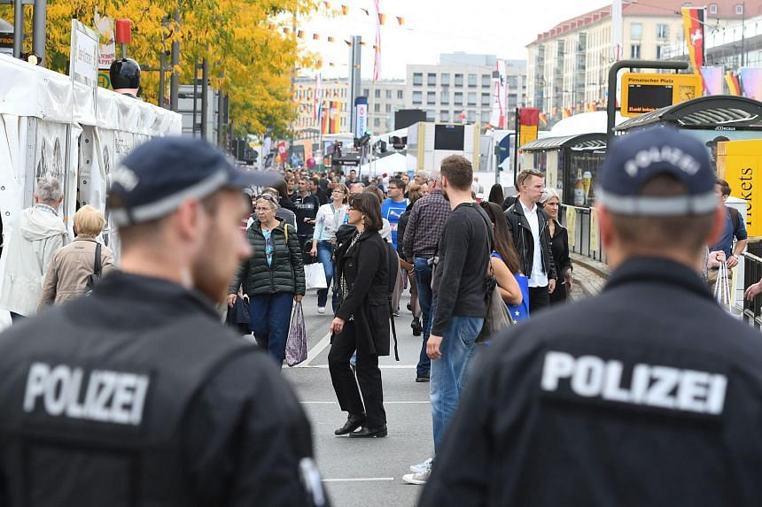 Police officers standing guard at the opening of the festival marking the Day of German Unity in Dresden on Oct 1, 2016.