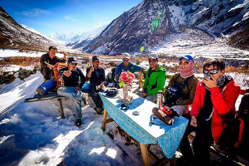 While climbing a mountain in Nepal, Mr Kow hurt his back in an accident and had to be airlifted to hospital. He credits his guides with saving his life as they cleared a spot for the helicopter to land and carried him to the aircraft. Nepalis taking