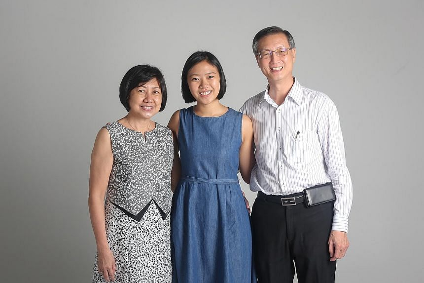 """Nineteen-year-old Gabrielle Ong, flanked by mum Ng Kwee Heong and dad Benjamin Ong, has decided against pursuing a degree in favour of working first despite receiving offers from four local universities. She sees it as learning from the """"university o"""