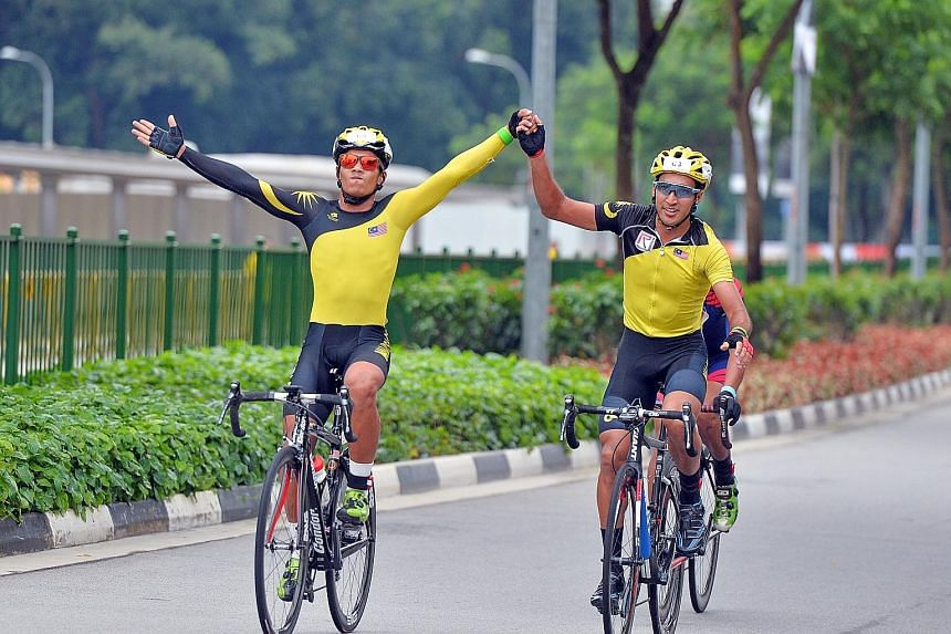 Malaysian cyclist Sofian Nabil Omar Mohd Bakri (left) and team-mate Muhammad Fauzan Ahmad Lutfi cruising to a comfortable win in the OCBC Cycle South-east Asia Speedway Championship final around the Singapore Sports Hub. Brunei were second and the Ph