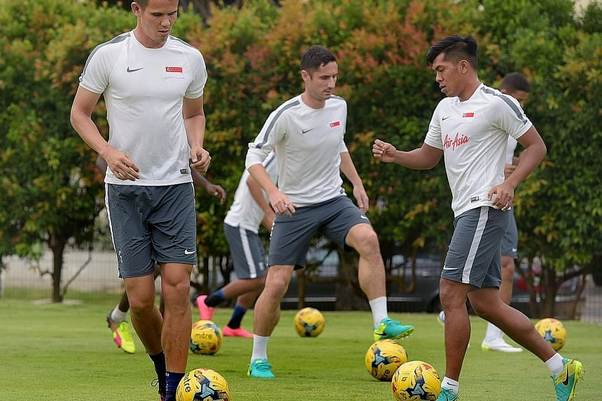 (From left) Baihakki Khaizan, Daniel Bennett and Khairul Amri at caretaker coach Sundram's first centralised training session ahead of two friendlies against Malaysia and Hong Kong. Irfan Fandi, son of local icon Fandi Ahmad, is in the senior squad f