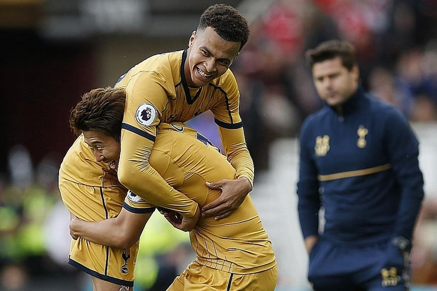 A wrestling move right out of the training ground? Not quite. But high-flying Tottenham have been reaping the rewards of Mauricio Pochettino's tough regimen, with Son Heung Min celebrating the first of his double with Dele Alli (lifted) in their 2-1
