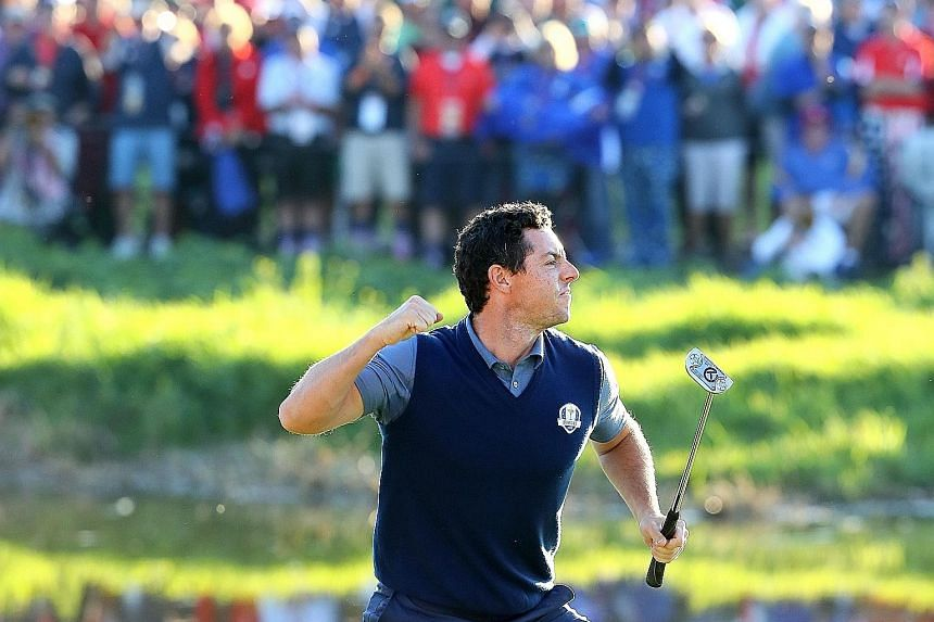 Rory McIlroy of Europe reacting on the 16th green after making a putt to win the match during afternoon four-ball matches of the Ryder Cup at Hazeltine National Golf Club on Friday.