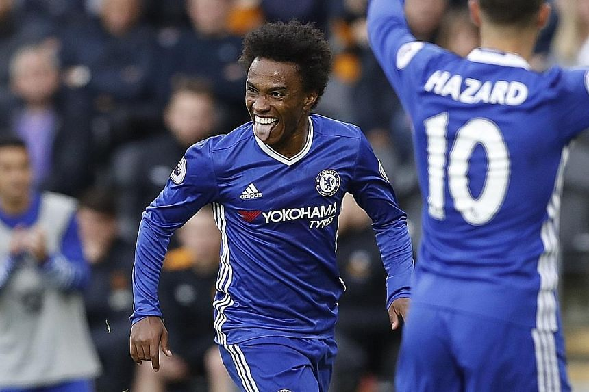 Chelsea fought hard for a 2-0 English Premier League win over Hull City yesterday, as they rebounded from two consecutive league defeats. The goals, coming in the space of seven minutes from Willian (61st, above) and Diego Costa (67th), moved the Blu