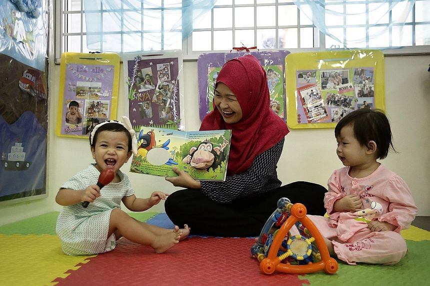 Ms Intan cares for infants like 16-month-olds Anna Aisha Khairul Anuar (left) and Wong Min En at My First Skool in Woodlands, which already closes on Teachers' Day.