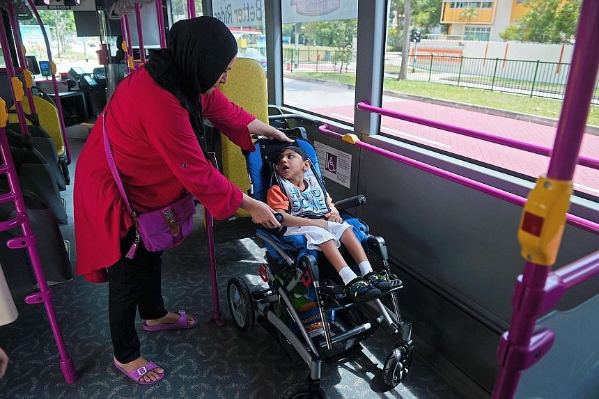 Madam Angullia taking her three-year-old son Arshad (above) to the Cerebral Palsy Alliance Singapore on bus service 518. On arrival, the bus driver (left) lowers the ramp for her to push her son out on his paediatric wheelchair.