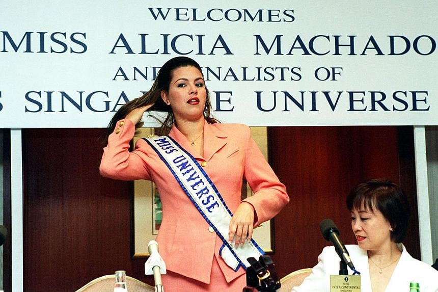 "Miss Universe Alicia Machado at a press conference in Singapore in 1997. She defended her weight then, saying she wanted to show people that one could be beautiful ""with a little more weight""."