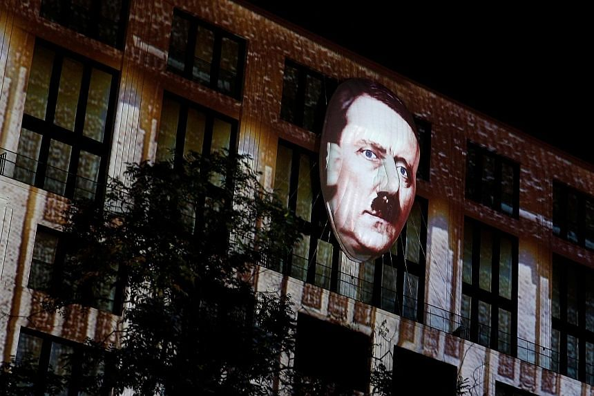 A video animation of Adolf Hitler during the Berlin Leuchtet festival on Friday, as part of a show that displays 150 years of the capital's history. The annual light festival in Berlin, Germany, runs from Sept 30 to Oct 16 this year.