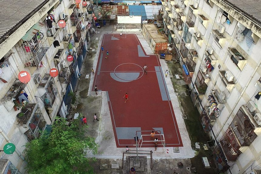 Think out of the box. Work round it and curl it if it works - in other words, bend it like Beckham. If a standard football pitch cannot be built, an asymmetrical pitch, like this one amid high-rise apartment buildings in the densely-inhabited Klong T