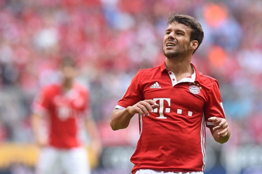 Bayern Munich's Spanish defender Juan Bernat reacts during the match.