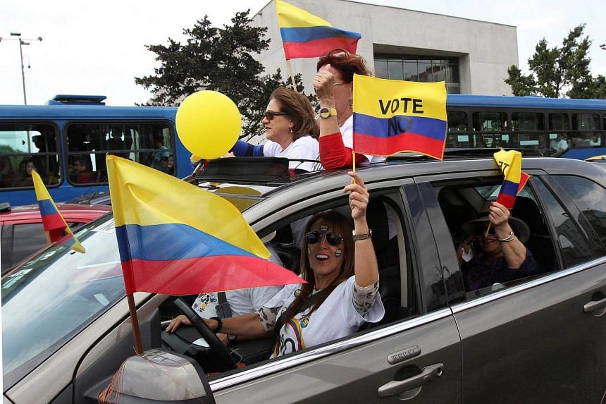 Demonstrators take part in an event organised by supporters of the no vote for the upcoming referendum on a peace deal between the government and FARC rebels in Bogota, Colombia.