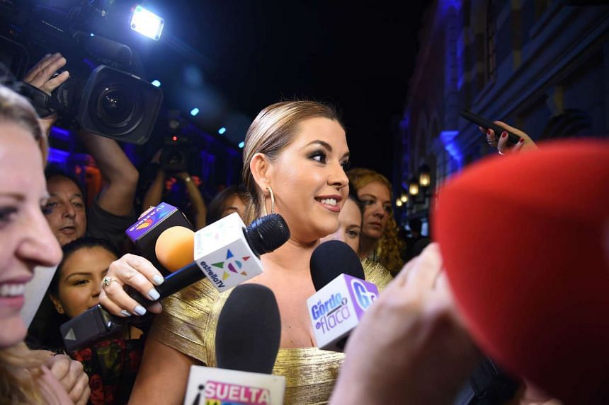 Former beauty queen Alicia Machado talking to members of the media at the Metropolitan Fashion Week Closing Gala & Awards Show in Los Angeles on Oct 1, 2016.