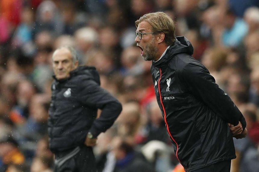 Liverpool manager Juergen Klopp (right) and Swansea City manager Francesco Guidolin.