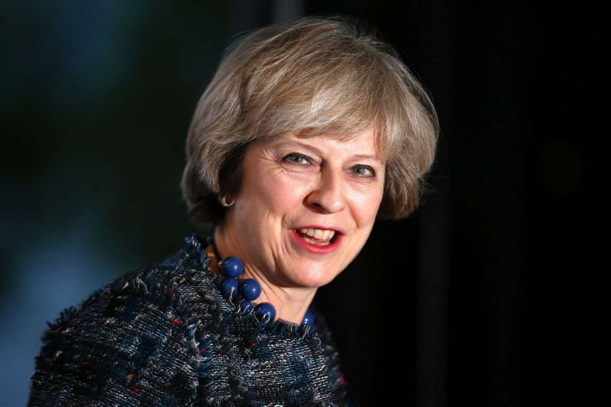 Britain's Prime Minister Theresa May arrives at a hotel on the eve of her Conservative party's annual conference on Oct 1, 2016.