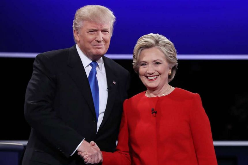 Democrat Hillary Clinton (right) and Republican Donald Trump at the start of the first presidential debate on Sept 26, 2016.