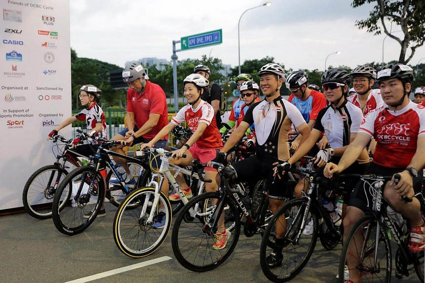 Sport Singapore CEO Lim Teck Yin and Minister for Culture, Community and Youth Grace Fu take part in the 23km The Straits Times ride.