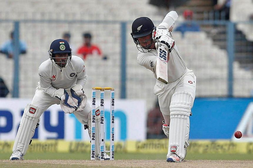 New Zealand's Luke Ronchi plays a shot during the second Test match between India and New Zealand at the Eden Gardens cricket stadium in Kolkata on Oct 1, 2016.