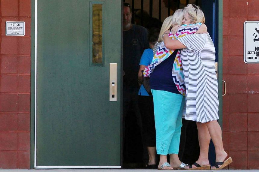 Teachers hug outside Townville Elementary School after a shooting in Townville, South Carolina, Sept 28, 2016.