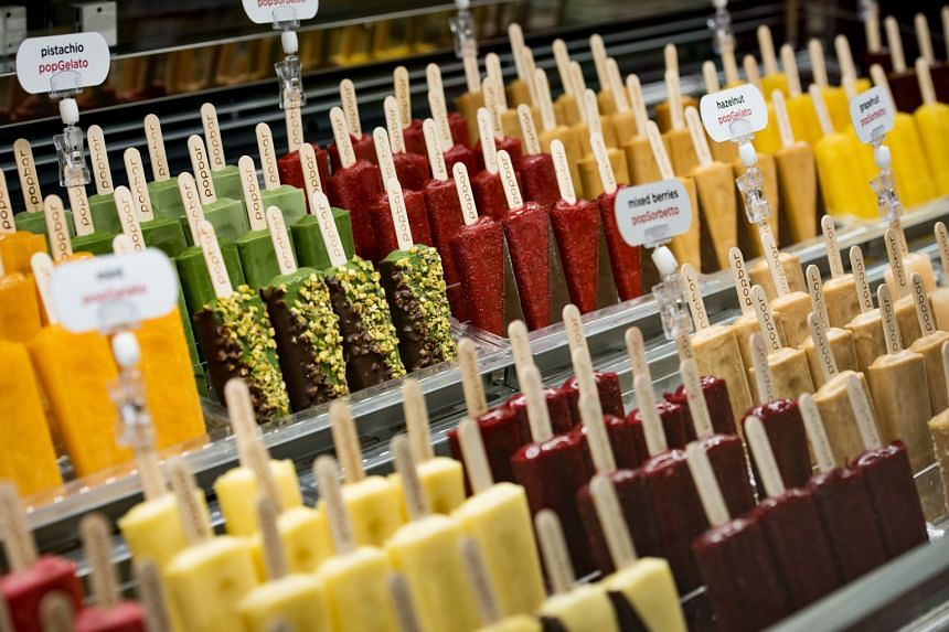 Instead of a cup or a cone, the gelato (above) is on a stick, and small batches of 26 popbars are produced at a time.