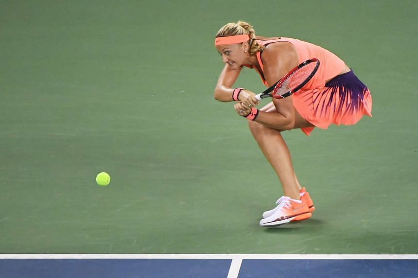 Czech Petra Kvitova hitting a return to Slovak Dominika Cibulkova in WTA Wuhan Open final. An overwhelming 6-1, 6-1 score gave her a second crown in the Chinese city and broke her 13-month title drought.