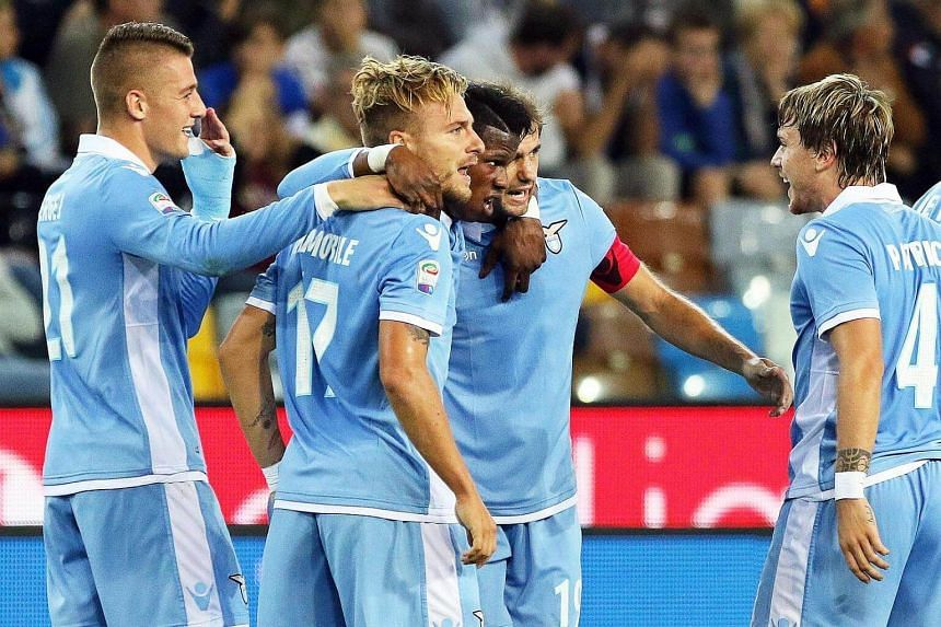 Lazio's Ciro Immobile (second from left) celebrates after scoring during the Italian Serie A soccer match between Udinese and Lazio at Friuli stadium.