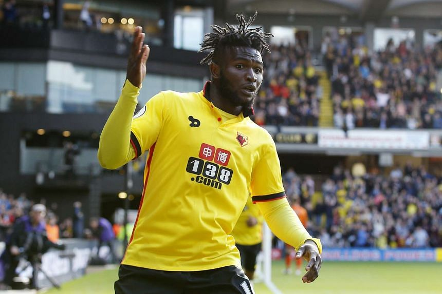 Watford's Isaac Success celebrates scoring their second goal.