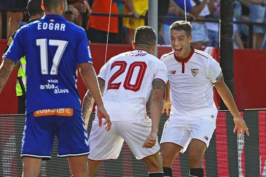 Wissam Ben Yedder (right) celebrates with his team-mate Victor Marin Vitolo after scoring the winning goal during the Spanish Primera Division soccer match between Sevilla FC and Deportivo Alaves on Oct 1.